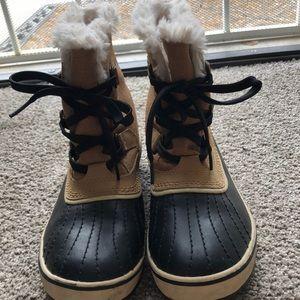 Tan Sorel waterproof boots.